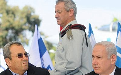IDF Chief of Staff Benny Gantz walks by Prime Minister Benjamin Netanyahu and Defense Minister Ehud Barak last year. (photo credit: Yossi Zeliger/Flash90)
