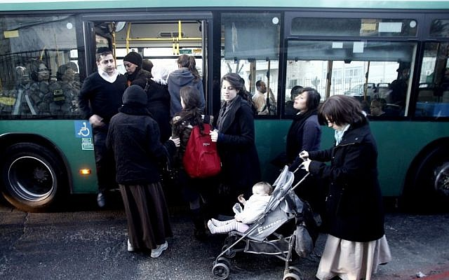 Illustrative photo of ultra-Orthodox women entering a gender-segregated bus in the Mea Shearim neighborhood of Jerusalem (photo credit: Uri Lenz/Flash90/File)