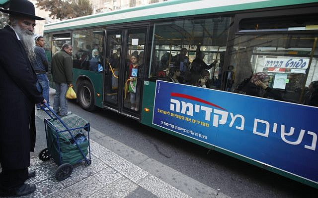 Advertisements posted on buses by the Kadima party draw attention to the exclusion of women in public advertisements. (photo credit: Miriam Alster/Flash90)