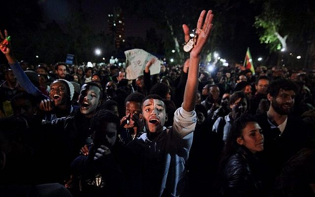 Hundreds Israeli Ethiopian demonstrators hold up banners and shout slogans as they demonstrate in Tel Aviv on January 25, 2012, against racism and discrimination. (photo credit: Dima Vazinovich/Flash90)