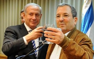 Benjamin Netanyahu toasts Ehud Barak on his 70th birthday in February 2012. (photo credit: Ministry of Defense/Flash90)