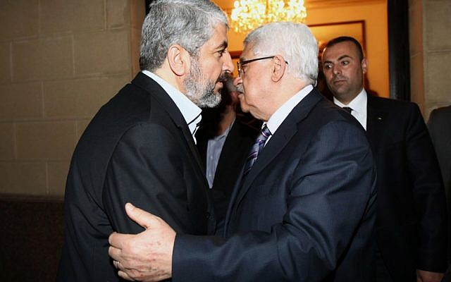 Palestinian Authority President Mahmoud Abbas meets with Hamas leader Khaled Mashaal in February  2012. (photo credit: Mohammed al-Hums/Flash90)