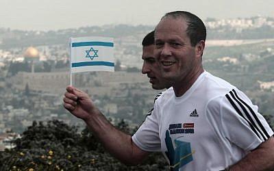 Jerusalem Mayor Nir Barkat takes part in the Jerusalem Marathon wearing an Adidas sponsored shirt (photo credit: Kobi Gideon/Flash90)