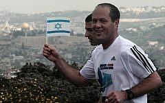 Jerusalem Mayor Nir Barkat running the Jerusalem Marathon in an Adidas shirt in March. (photo credit: Kobi Gideon/Flash90)