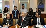 Benjamin Netanyahu (center) in the Knesset on Sunday morning (photo credit: Avi ohayon/Flash90)