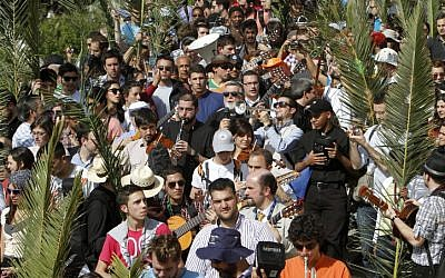 Christian pilgrims participate in the traditional Palm Sunday procession on Jerusalem's Mount of Olives. (photo credit: Miriam Alster/Flash90)