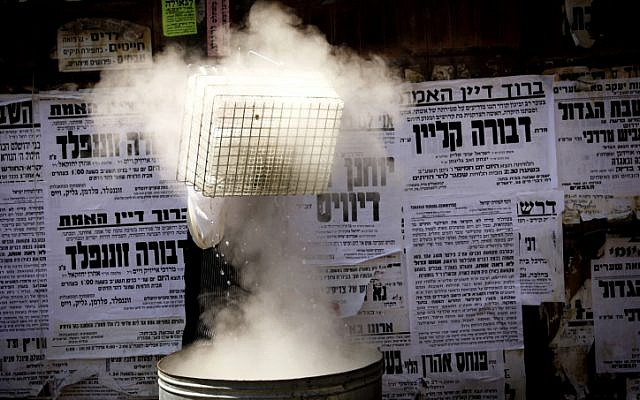 The Passover cleaning process in Meah Shearim (Photo credit: Miriam Alster/ Flash 90)