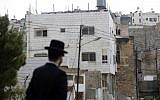 An ultra-Orthodox Jewish man walks past Beit Hamachpela in Hebron. (photo credit: Uri Lenz/Flash 90)
