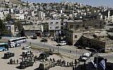 Security forces surround Beit Hamachpela in Hebron. (photo credit: Miriam Alster/Flash90)