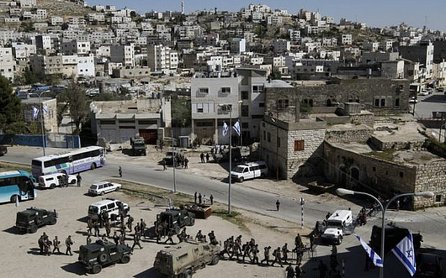 Security forces surround Beit Hamachpela in Hebron. (photo credit: Miriam Alster/Flash90)