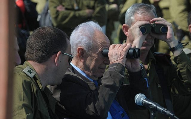 President Shimon Peres and IDF Chief of Staff Lt. Gen. Benny Gantz observe a military exercise on the Golan Heights in April 2012. (photo credit: Mark Neyman/GPO/Flash90)