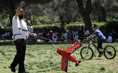 A man flying a kite with his children in Jerusalem's Sacher Park Tuesday (photo credit: Miriam Alster/Flash90)
