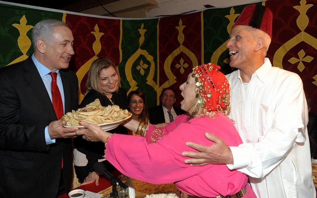 Benjamin and Sara Netanyahu celebrating the Mimouna, a traditional Jewish-Moroccan holiday that follows the end of passover (Amos Ben Gershom/Flash90)
