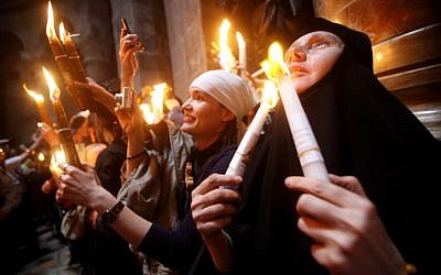 Orthodox Christian worshippers take part in the Holy Fire ceremony at the Church of the Holy Sepulcher in Jerusalem's Old City. (photo credit: Uri Lenz/Flash90)