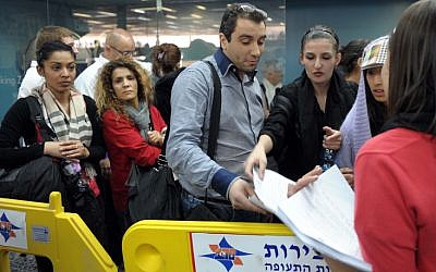Passengers disembarking from international flights at Ben Gurion Airport Sunday (photo credit: Avi Ohayon/GPO/Flash90)