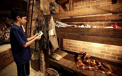An Israeli boy inside a reconstructed bunker at the 'From Holocaust to Revival' museum in Kibbutz Yad Mordechai (photo credit: Flash90)