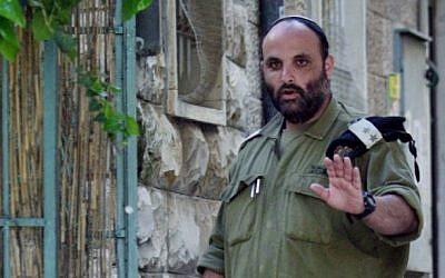 IDF Lieutenant Colonel Shalom Eisner arrives at his home in Jerusalem on April 17, 2012 (photo credit: by Uri Lenz/Flash90)