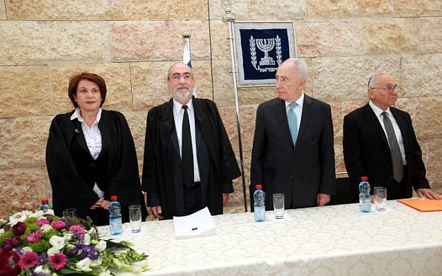 Justice Minister Yaakov Neeman (right), President Shimon Peres (center) and Supreme Court President Asher Grunis (second from the left) at a swearing-in ceremony for new judges in Jerusalem. (photo credit: Yossi Zamir/Flash90)