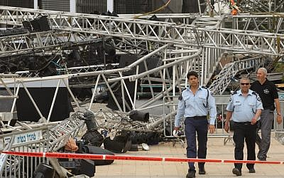 In this 2012 photo, a police officer stands near the scene where a large lighting rig collapsed and killed Second Lieutenant Hila Betzaleli (photo credit: Nati Shohat/Flash90)