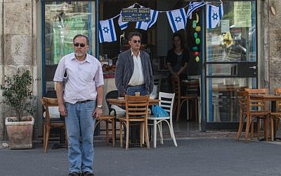 Israelis observing a moment of silence in Jerusalem on Wednesday. (photo credit: Uri Lenz / Flash90)
