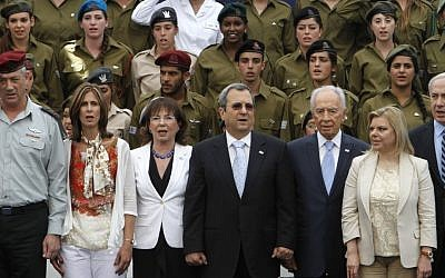 From left to right: IDF Chief of Staff Benny Gantz, Revital Gantz, Nili Priel (wife of Ehud Barak), Defense Minister Ehud Barak, President Shimon Peres, Sara Netanyahu and Prime Minister Benjamin Netanyahu participate in an Independence Day ceremony for outstanding soldiers at the President's Residence in Jerusalem, April 26, 2012. (photo credit: Miriam Alster/Flash90)
