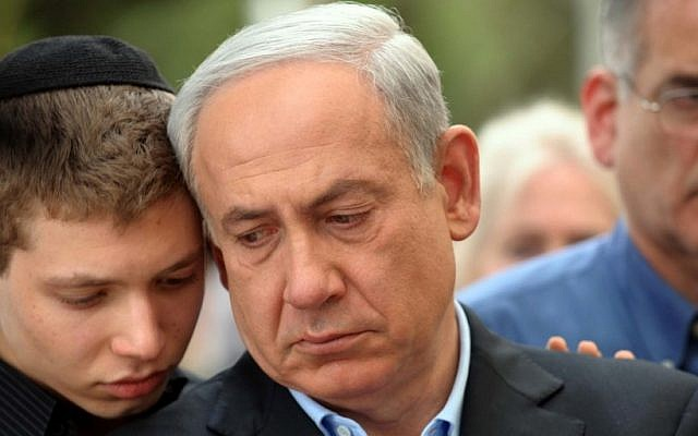 Prime Minister Benjamin Netanyahu with his son Yair at the funeral of Netanyahu's father, Benzion, in Jerusalem, on Monday April 30, 2012. (photo credit: Avi Ohayon/GPO/Flash90)