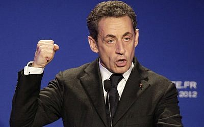 French President Nicolas Sarkozy gestures as he delivers a speech during a campaign meeting outside Paris on Thursday. (photo credit: Michel Euler/AP)