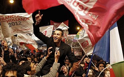 Supporters of Socialist candidate Francois Hollande celebrate in Paris (photo credit: AP/Laurent Cipriani)
