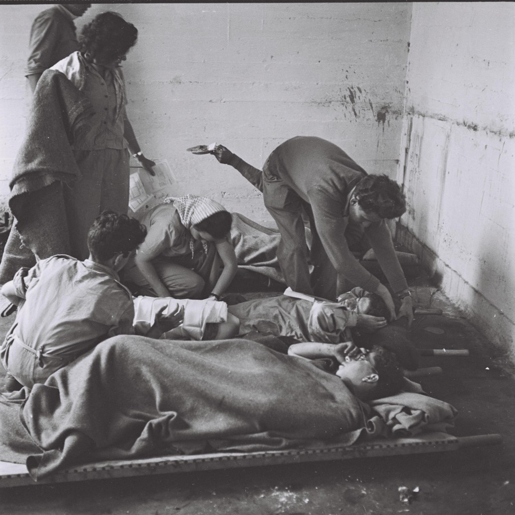 Nurses treat Haganah wounded during the fighting in Jerusalem, May 28, 1948 (Courtesy of the Government Press Office. Photographer: Shershel Frank)