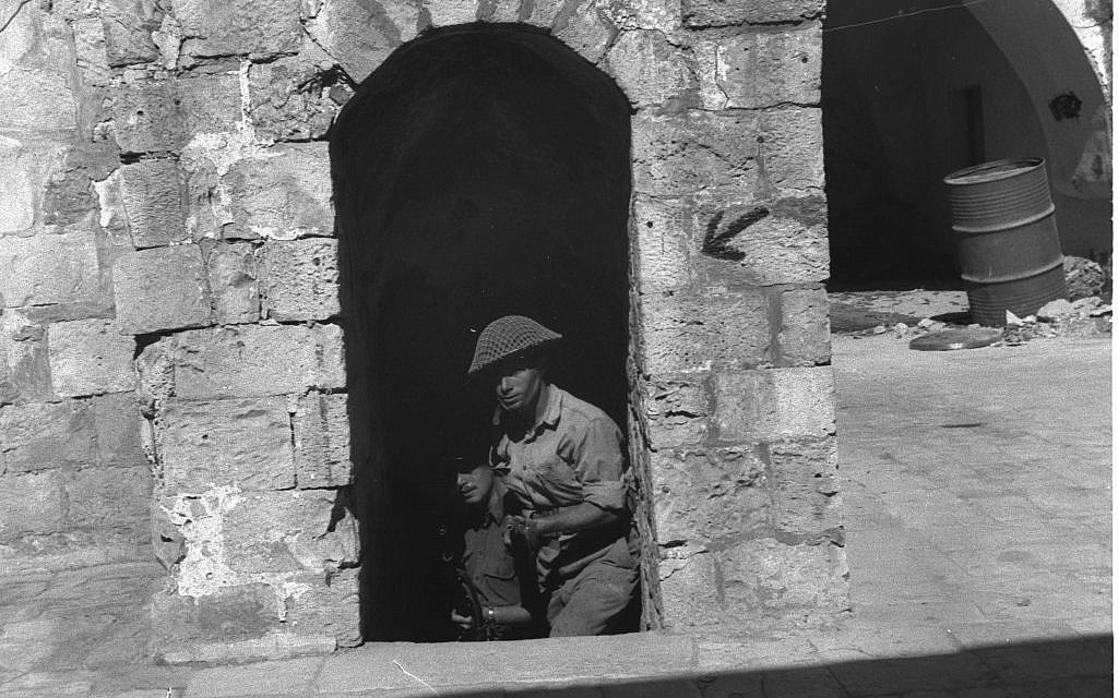 Jewish fighters outside the Old City walls, 1948. (Courtesy of the Government Press Office, Jerusalem)