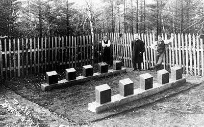 A photograph taken at the Titanic section in the Baron de Hirsch Cemetery in Halifax, Nova Scotia, in November 1912. Left to right: Frank Fitzgerald, a man believed to be Rabbi Jacob Walter, and Fred Bishop, who was responsible for ordering, cutting, and engraving stone, per a contract with the White Star Line. (photo credit: Russ Lownds via the John P. Eaton/Charles A. Haas Titanic Photograph Archive)