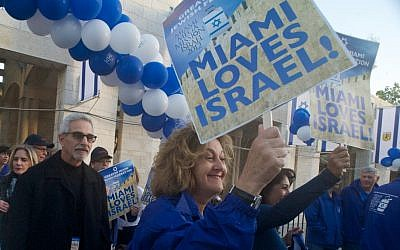 Ana and Steven Weisman and Stephanie Trump march to Jerusalem's Jaffa Gate during the 2012 'mega event' of the Greater Miami Jewish Federation's mission of 700 people to Israel. (Randi Sidman-Moore/JTA)