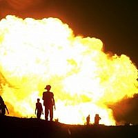 Flames rise from a gas pipeline explosion in el-Arish, Egypt in July, 2012. The pipeline that transports fuel to Israel and Jordan has been attacked many times since the fall of former president Hosni Mubarak. (AP/File)