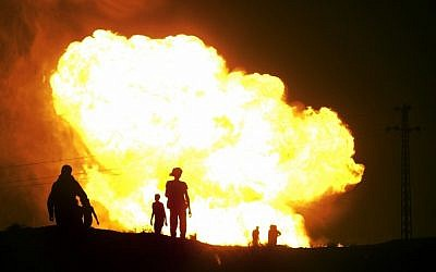 Flames rise from a gas pipeline explosion in el-Arish, Egypt in July, 2012. The pipeline that transports fuel to Israel and Jordan has been attacked many times since the fall of former president Hosni Mubarak. (photo credit: AP/File)