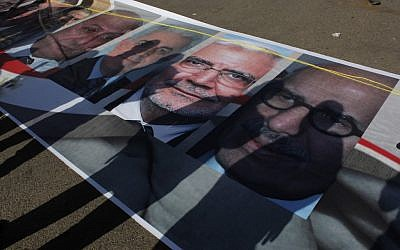 Posters of Egyptian presidential candidates in a Tahrir Square rally last month (photo credit: AP/Nasser Nasser)