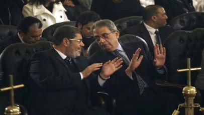 Moussa and Muslim Brotherhood candidate Muhammad Mursi (photo credit: AP Photo/Maya Alleruzzo)