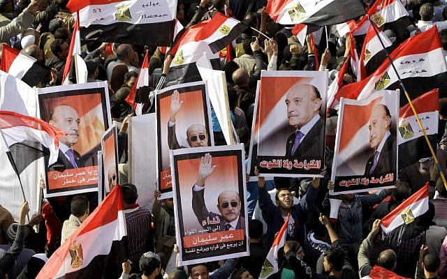 File photo of Egyptians holding posters supporting Omar Suleiman, in Cairo, Egypt last December. (photo credit: AP/Amr Nabil, File)