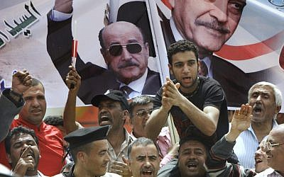 Supporters of former Egyptian vice president Omar Suleiman's presidential campaign in Cairo, Egypt, on April 8, 2012. (photo credit: AP/Amr Nabil)