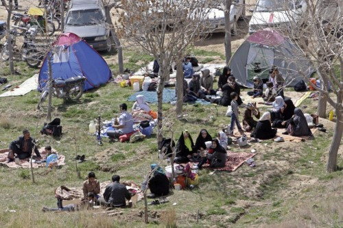Iranian families picnicking in celebration of the ancient festival of Sizdeh Bedar. (photo credit: AP/Vahid Salemi)