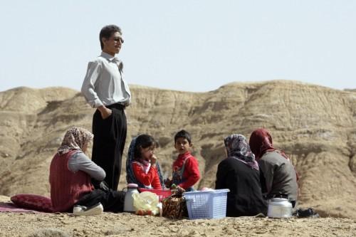 An Iranian family picnics while marking the ancient festival of Sizdeh Bedar outside Esfarayen, Iran. (photo credit: AP/Vahid Salemi)