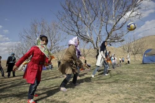 Iranian women play ball during a picnic marking ancient festival of Sizdeh Bedar near Esfarayen, Iran. (photo credit: AP/Vahid Salemi)