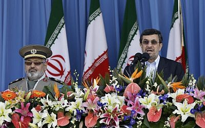 Iranian President Mahmoud Ahmadinejad, right, speaks during a parade commemorating National Army Day in April (photo credit: Vahid Salemi/AP)