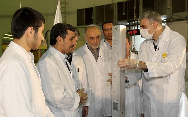 Iranian President Mahmoud Ahmadinejad, second from left, visits a nuclear research facility in Tehran in February 2012 (photo credit: AP/Iranian President's Office)