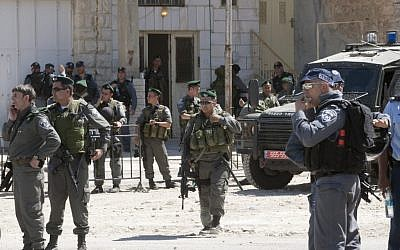 Illustrative. IDF troops in the West Bank city of Hebron (Sebastian Scheiner/AP)
