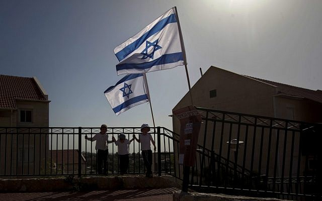 Israeli flags fly over the Ulpana outpost on the outskirts of Beit El, a settlement in the West Bank (photo credit: AP)