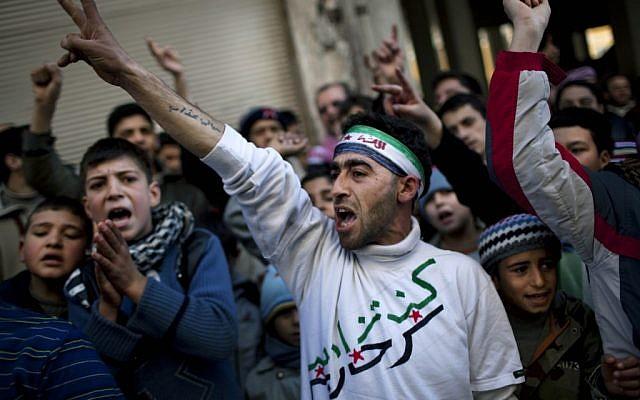 Anti-Assad protest in Syria (photo credit: AP Photo/Rodrigo Abd)