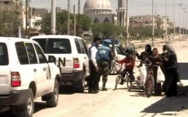 UN observers visit the city of Homs on Saturday (photo credit: Syria TV/AP video)
