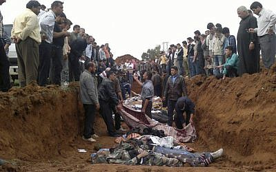 This citizen journalist image obtained by AP shows a mass burial of people allegedly killed in the shelling in Taftanaz, Syria. AP cannot independently verify the location, content, or authenticity of the photo. (photo credit: AP)