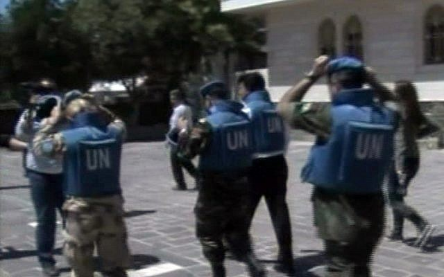 United Nations observers visit Homs on Saturday. (photo credit: AP/Syria TV)
