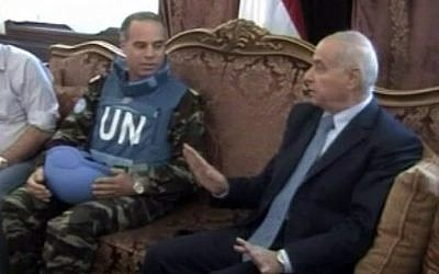 U.N. observer team leader Col. Ahmed Himmiche, left, meeting with the governor of Homs, April 21, 2012.  (photo credit: AP Photo/Syria TV via AP video)